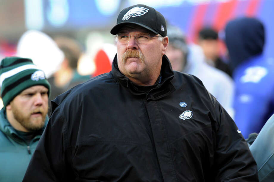 Philadelphia Eagles head coach Andy Reid walks on the field before an NFL football game against the New York Giants, Sunday, Dec. 30, 2012, in East Rutherford, N.J. (AP Photo/Bill Kostroun) / FR51951 AP
