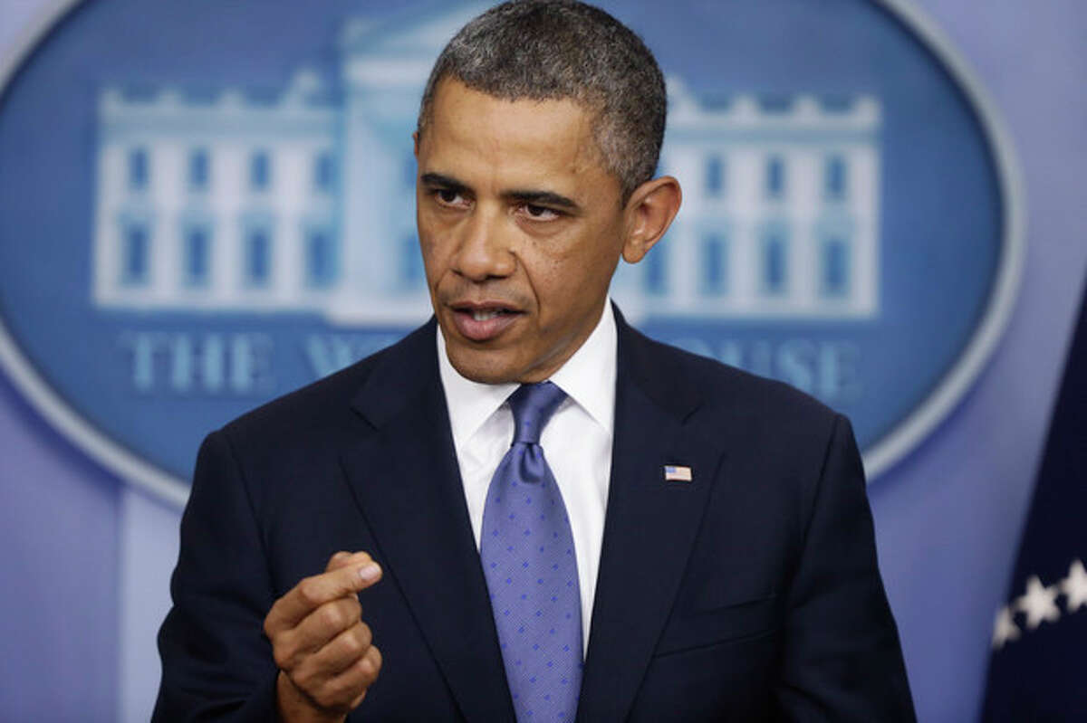 President Barack Obama speaks to reporters in the Brady Press Briefing Room at the White House in Washington after meeting with Congressional leaders regarding the fiscal cliff, Friday, Dec. 28, 2012. (AP Photo/Charles Dharapak)