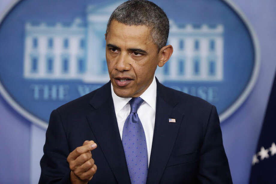 President Barack Obama speaks to reporters in the Brady Press Briefing Room at the White House in Washington after meeting with Congressional leaders regarding the fiscal cliff, Friday, Dec. 28, 2012. (AP Photo/Charles Dharapak) / AP