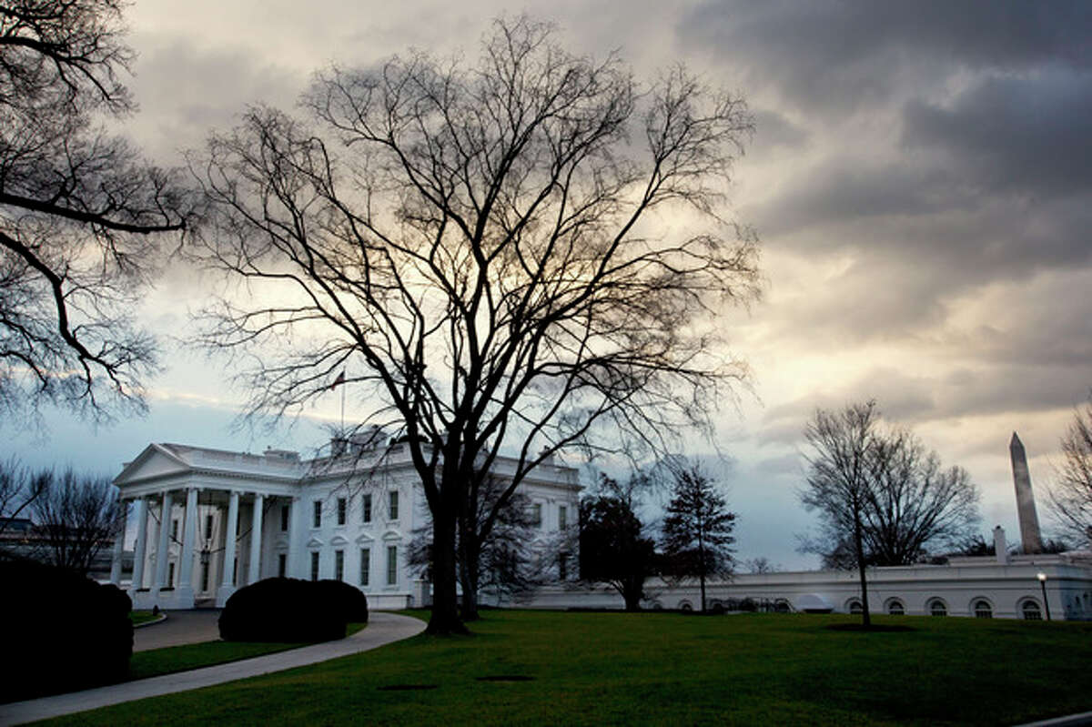 Clouds roil over the White House in Washington on the morning of Sunday, Dec. 30, 2012, as Washington has less than 48 hours to avert the ?