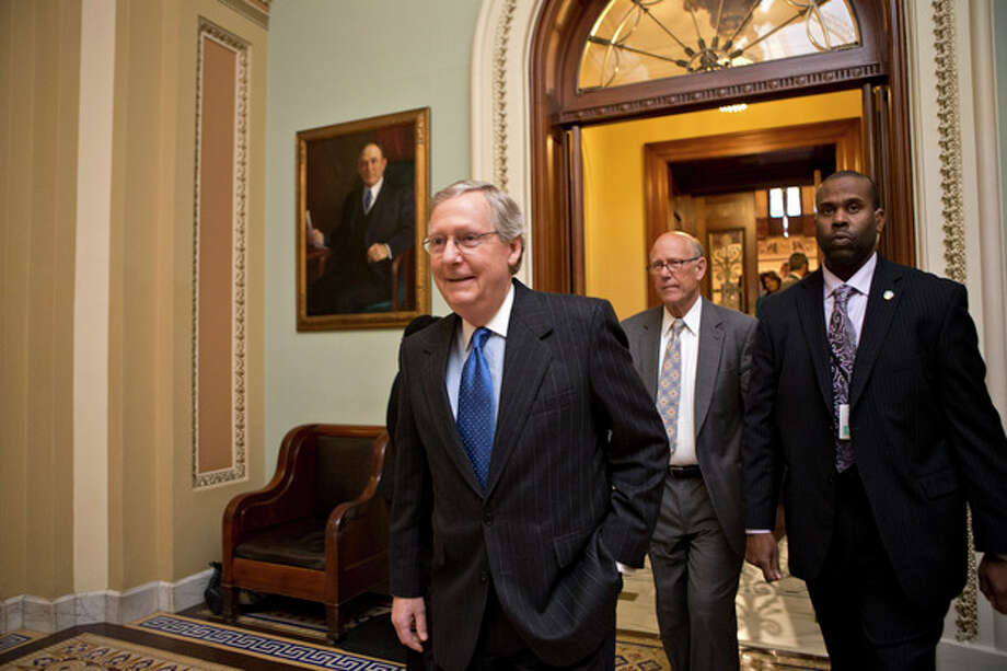 "Senate Minority Leader Mitch McConnell, R-Ky., followed by Sen. Pat Roberts, R-Kan., second from right, leaves the Senate chamber to meet with fellow Republicans in a closed-door session as the ""fiscal cliff"" negotiations continue at the Capitol in Washington, Sunday, Dec. 30, 2012. Leaders in the Senate and the House are under pressure to find a legislative path to head off the automatic tax hikes and spending cuts set to take effect Jan. 1, 2013. (AP Photo/J. Scott Applewhite) / AP"