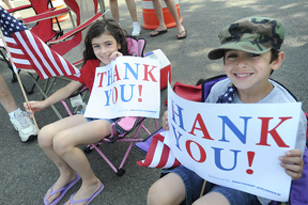 Laura Frattaroli 8, and her brother John 7, at the Norwalk Memorial Day Parade. hour photo/Matthew Vinci