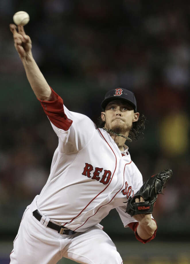 Boston Red Sox's Clay Buchholz delivers a pitch against the New York Yankees in the first inning of a baseball game at Fenway Park, in Boston, Sunday, Sept. 15, 2013. (AP Photo/Steven Senne)