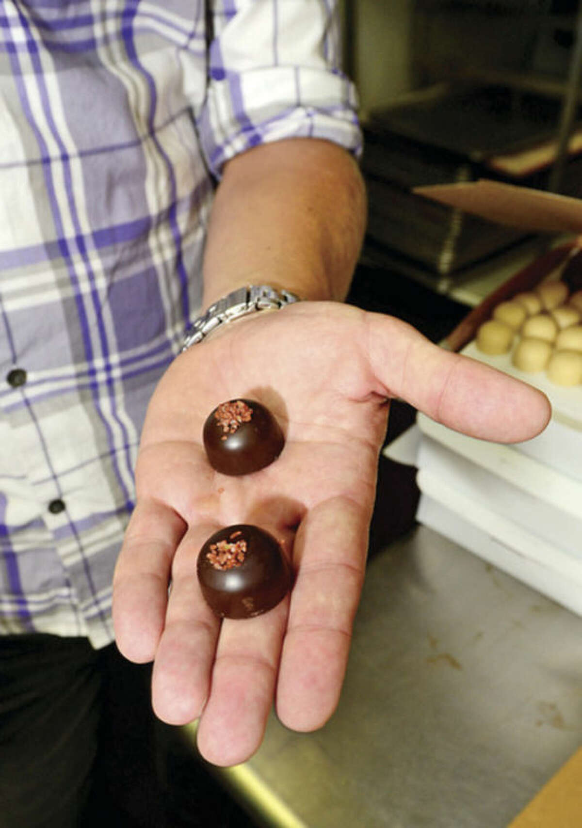 @Cutline Byline:Hour photo / Erik Trautmann Fritz Knipschildt and his employees at Knipschildt Chocolatier / Chocopologie restaurant produce high quality chocolates including some made with sea salt in South Norwalk.