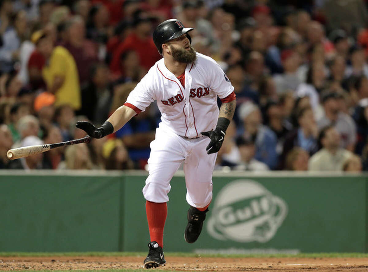 Boston Red Sox's Mike Napoli watches the flight of his two-run home run off a pitch by New York Yankees' Ivan Nova in the first inning of a baseball game at Fenway Park, in Boston, Sunday, Sept. 15, 2013. (AP Photo/Steven Senne)