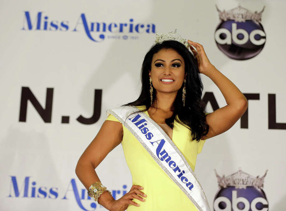 Miss New York Nina Davuluri poses for photographers following her crowning as Miss America 2014, Sunday, Sept. 15, 2013, in Atlantic City, N.J. (AP Photo/Mel Evans) / AP
