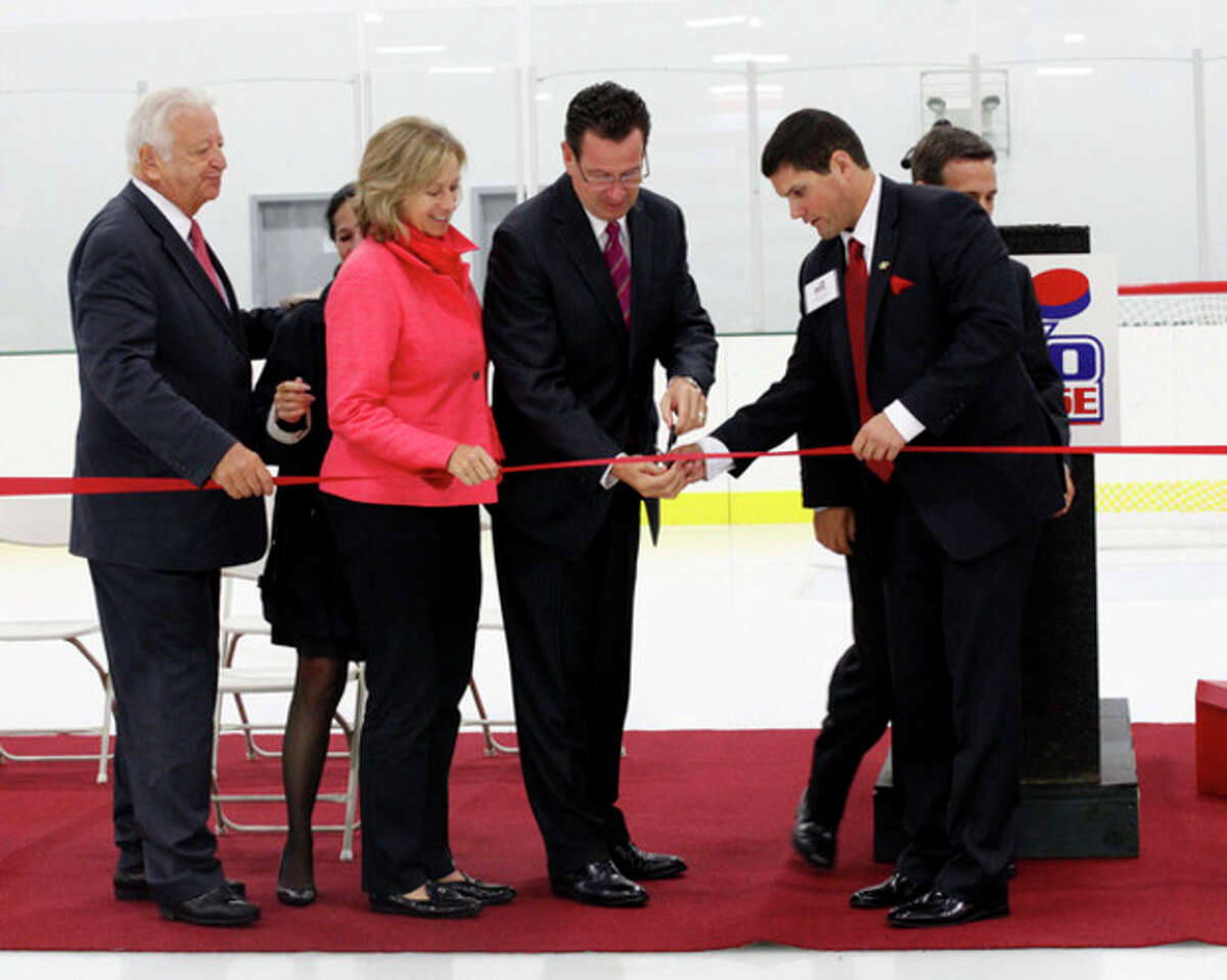 The ribbon is cut on SoNo Ice House's opening night Friday evening. Hour Photo / Danielle Robinson