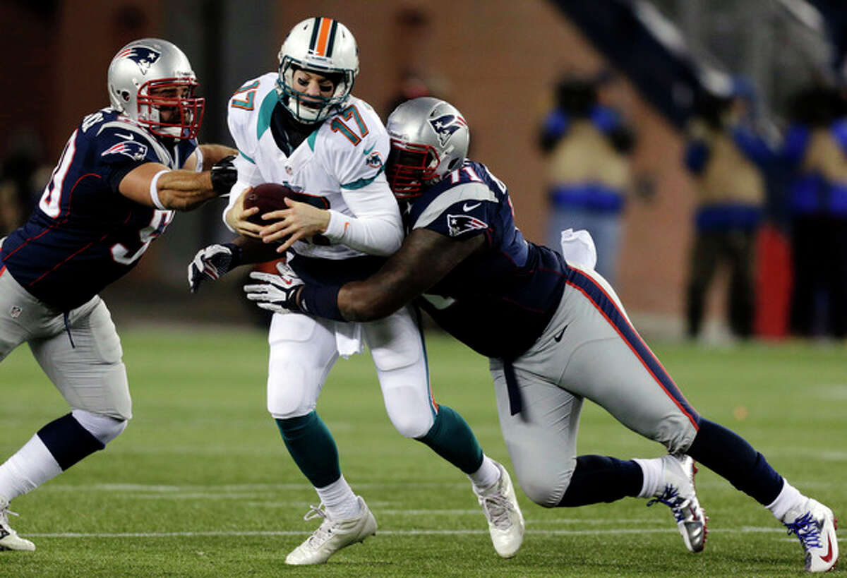 New England Patriots defensive tackle Brandon Deaderick (71) sacks Miami Dolphins quarterback Ryan Tannehill (17) as Patriots defensive end Rob Ninkovich, left, closes in during the first quarter of an NFL football game in Foxborough, Mass., Sunday, Dec. 30, 2012. (AP Photo/Charles Krupa)