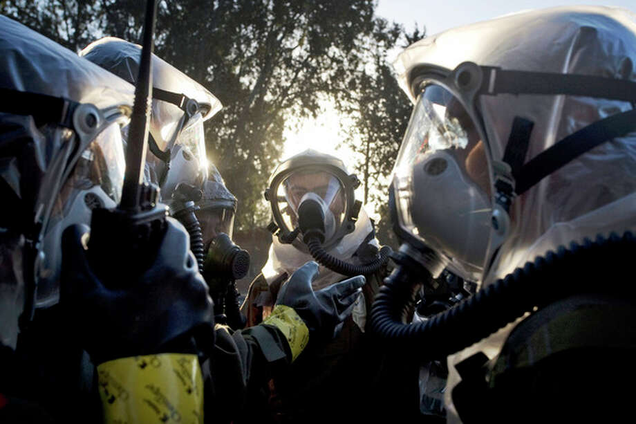 FILE - In this Thursday, Feb. 26, 2009 file photo Israeli soldiers wear gas masks as they take part in a home front command army drill simulating a chemical missile attack at an army base near Tel Aviv. The U.S.-Russian plan to dismantle Syria's chemical weapons is drawing some unwanted attention on Israel's own alleged chemical stockpile and could raise pressure on the Jewish state to come clean about its capabilities. (AP Photo/Sebastian Scheiner, File) / AP