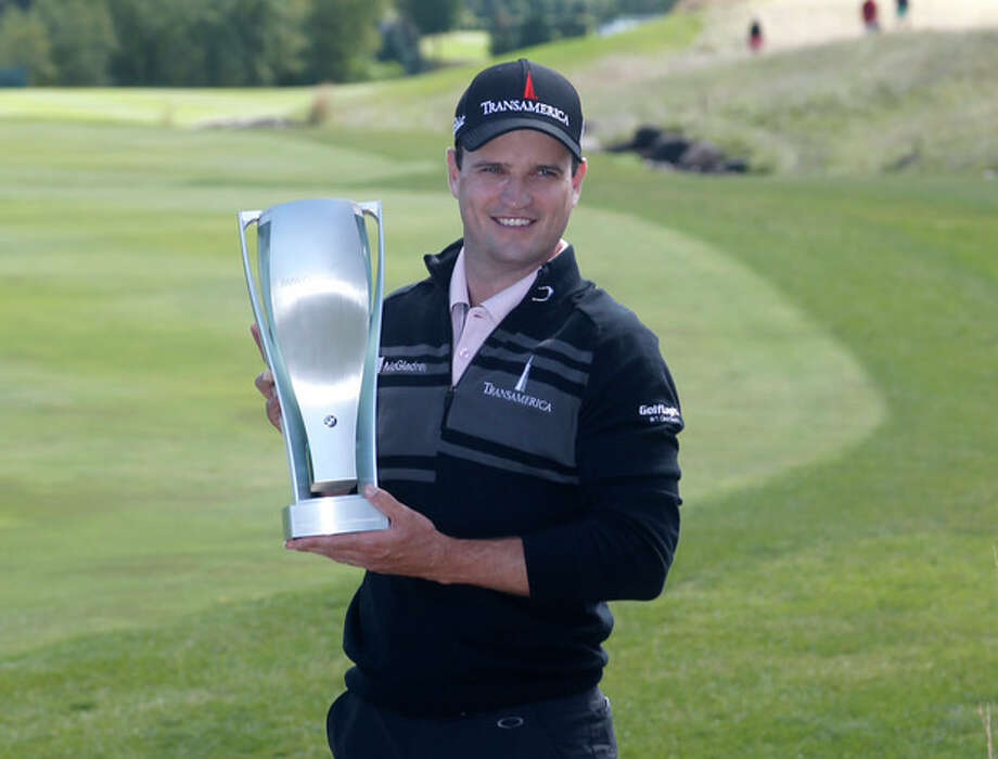 Zach Johnson poses with the BMW Championship trophy after winning the BMW Championship golf tournament at Conway Farms Golf Club in Lake Forest, Ill., Monday, Sept. 16, 2013. (AP Photo/Charles Rex Arbogast) / AP
