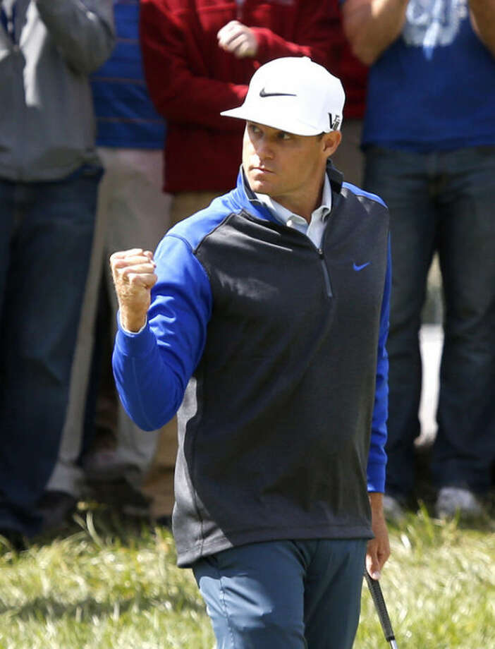 Nick Watney pumps his fist after making a birdie on the 17th green during the final round of the BMW Championship golf tournament at Conway Farms Golf Club, Monday, Sept. 16, 2013, in Lake Forest, Ill. (AP Photo/Charles Rex Arbogast)