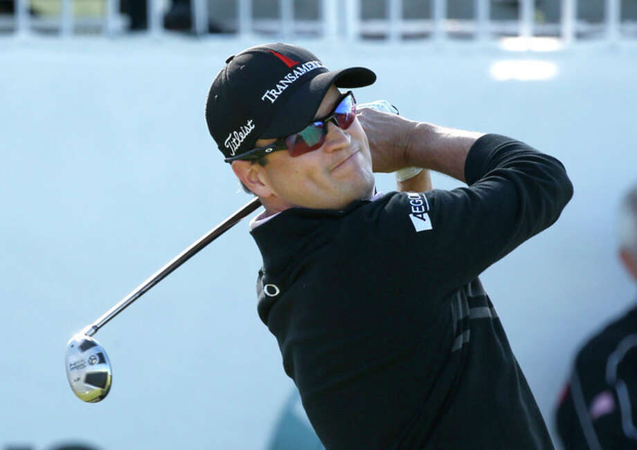 Zach Johnson watches his tee shot on the first hole during the final round of the BMW Championship golf tournament at Conway Farms Golf Club in Lake Forest, Ill., Monday, Sept. 16, 2013. (AP Photo/Charles Rex Arbogast) / AP
