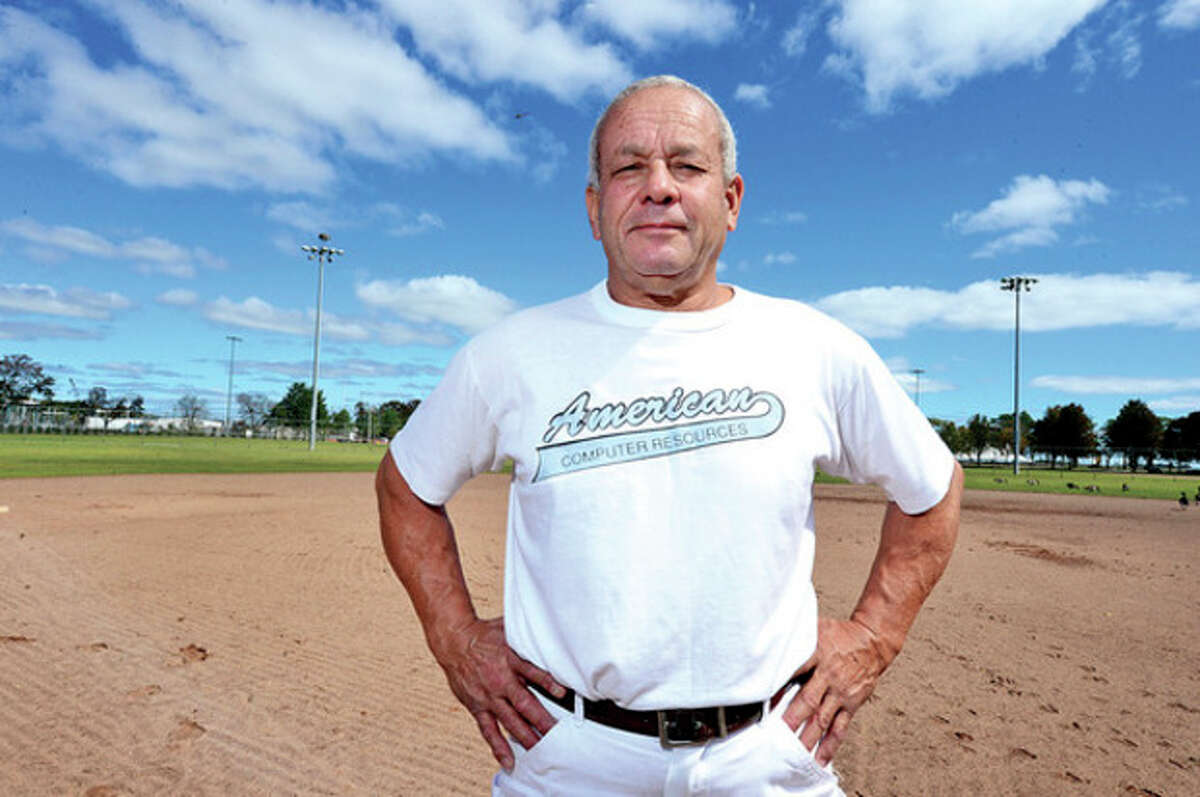 Hour photo/Erik Trautmann Felix Rodriguez stands on one of the softball fields at Calf Pasture where he enjoyed many memorable moments in his long career while wearing the jersey of one of the many teams for which he once played.