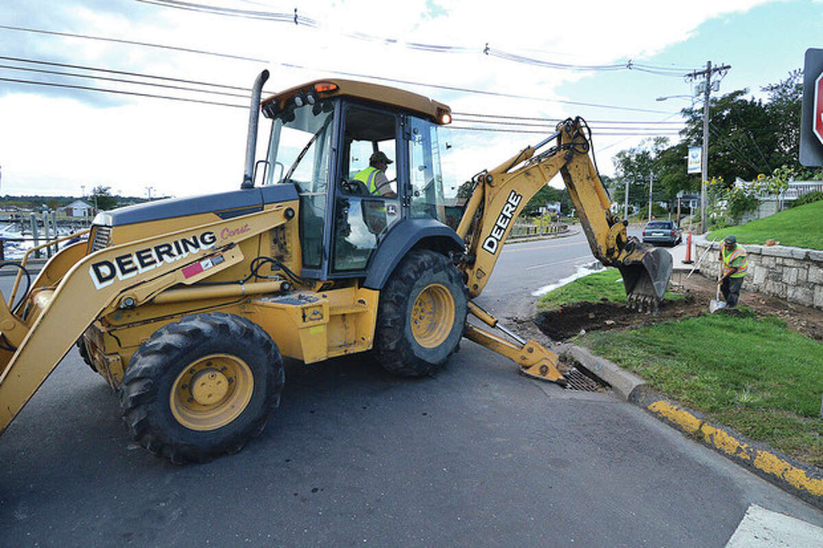 Construction works on a new section of sidewalk at the intersection of East Avenue and Seaview Avenue in Norwalk on Monday.