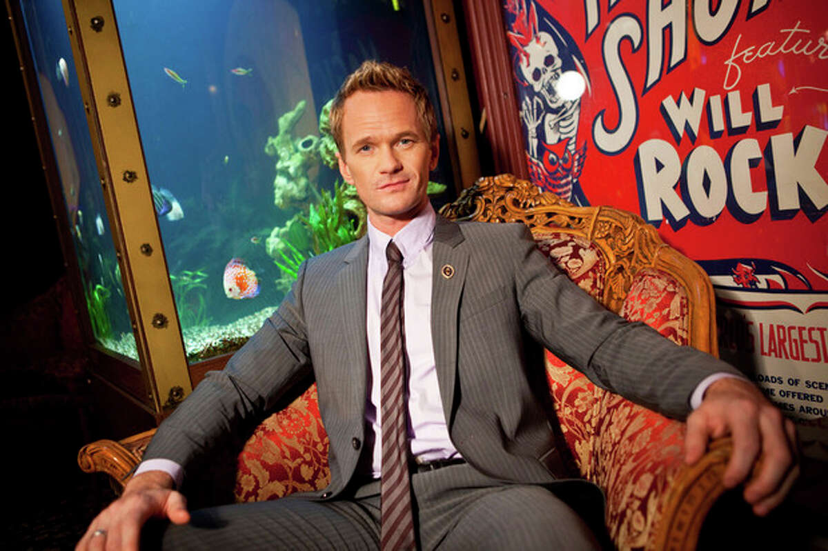 In this photo taken on Tuesday, Sept 10, 2013, Neil Patrick Harris poses for a portrait at the Magic Castle on in Los Angeles. As the 41-year-old entertainer prepares to host the 65th Primetime Emmy Awards on Sunday, Sept. 22, he talks to Associated Press about his magical past and present and plans for the future. He?'s actually magical, like in the abracadabra way, and has been since he was a kid. (Photo by Zach Cordner/Invision/AP)
