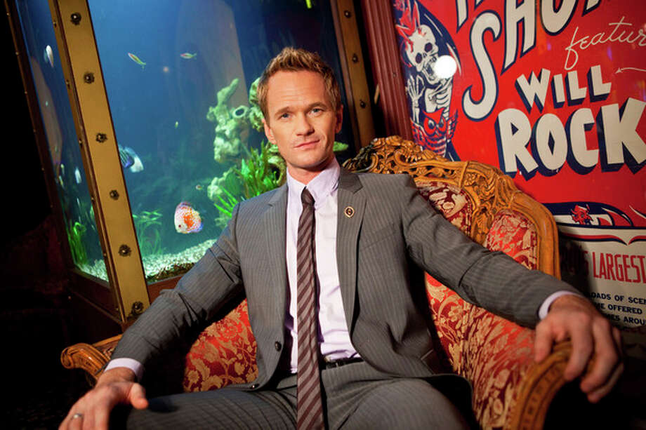 In this photo taken on Tuesday, Sept 10, 2013, Neil Patrick Harris poses for a portrait at the Magic Castle on in Los Angeles. As the 41-year-old entertainer prepares to host the 65th Primetime Emmy Awards on Sunday, Sept. 22, he talks to Associated Press about his magical past and present and plans for the future. He's actually magical, like in the abracadabra way, and has been since he was a kid. (Photo by Zach Cordner/Invision/AP) / Invision