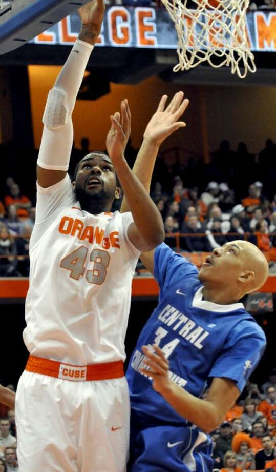 Syracuse's James Southerland (43) shoots against Central Connecticut State's Brandon Peel during the second half of an NCAA college basketball game in Syracuse, N.Y., Monday, Dec. 31, 2012. Syracuse won 96-62. (AP Photo/Kevin Rivoli)