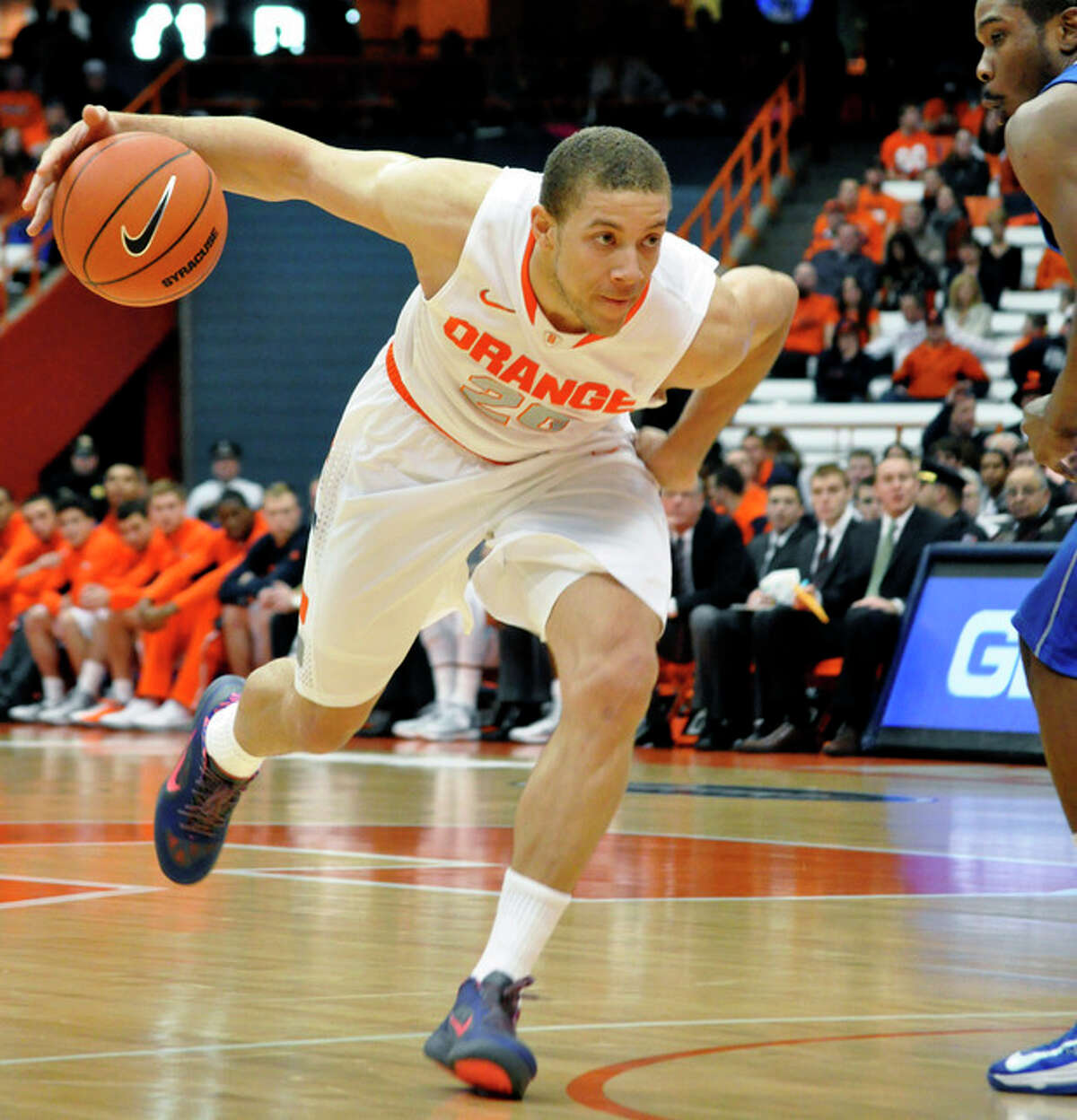 Syracuse's Brandon Triche drives aganst Central Connecticut State during the first half of an NCAA college basketball game in Syracuse, N.Y., Monday, Dec. 31, 2012. Syracuse won 96-62. (AP Photo/Kevin Rivoli)