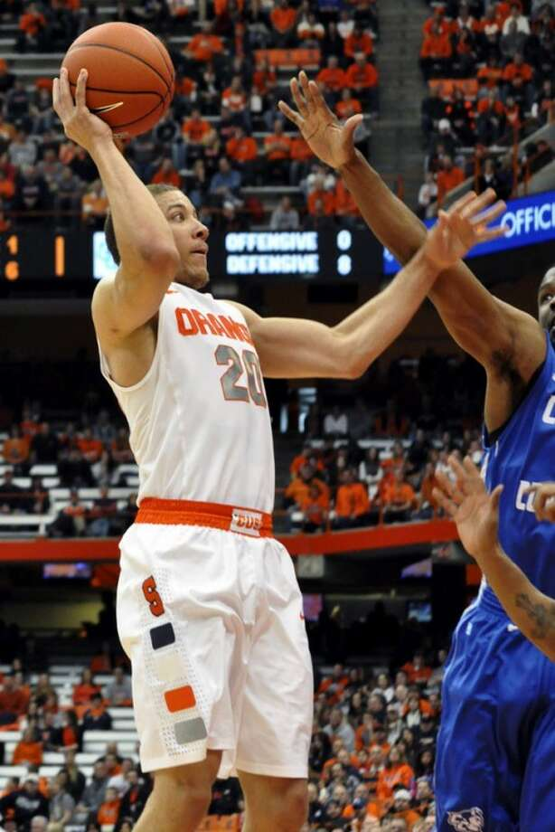 Syracuse's Brandon Triche shoots aganst Central Connecticut State during the first half of an NCAA college basketball game in Syracuse, N.Y., Monday, Dec. 31, 2012. (AP Photo/Kevin Rivoli)