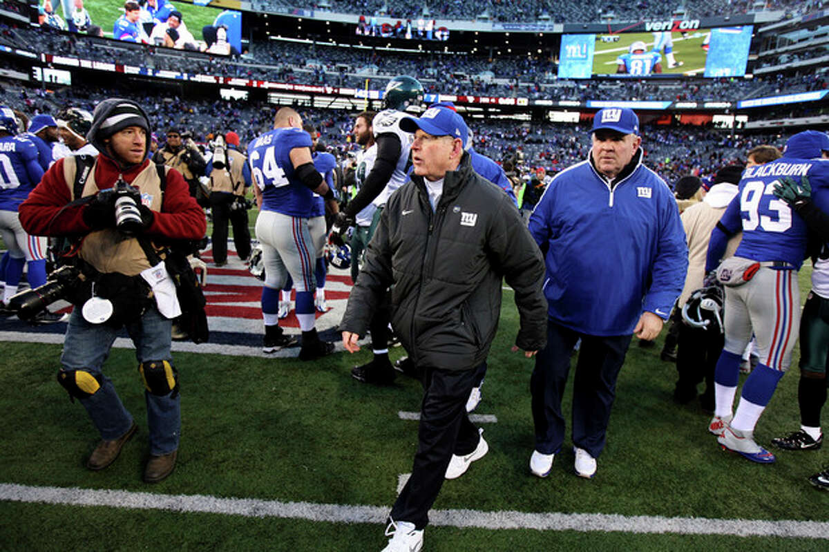 New York Giants head coach Tom Coughlin leaves the field after their 42-7 win over the Philadelphia Eagles in an NFL football game, Sunday, Dec. 30, 2012, in East Rutherford, N.J. (AP Photo/The Record of Bergen County, Thomas E. Franklin) ONLINE OUT; MAGS OUT; TV OUT; INTERNET OUT; NO ARCHIVING; MANDATORY CREDIT