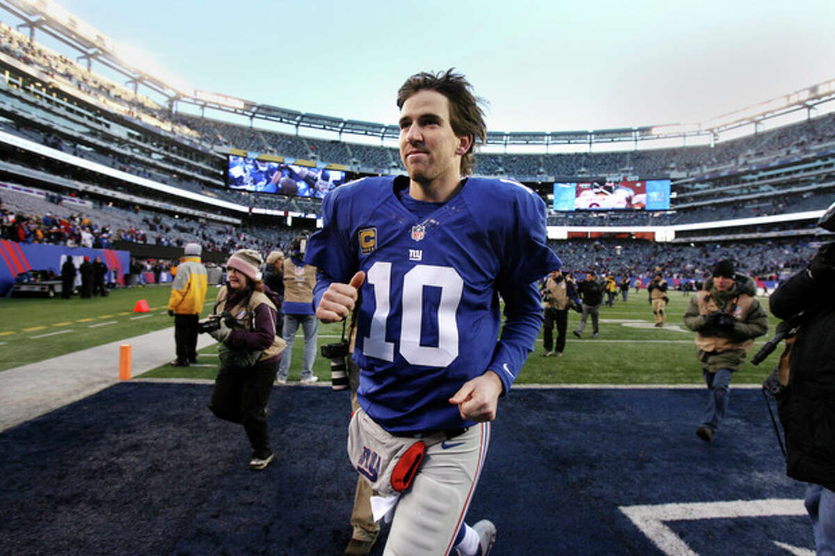 New York Giants quarterback Eli Manning leaves the field after their 42-7 win over the Philadelphia Eagles in an NFL football game, Sunday, Dec. 30, 2012, in East Rutherford, N.J. (AP Photo/The Record of Bergen County, Thomas E. Franklin) ONLINE OUT; MAGS OUT; TV OUT; INTERNET OUT; NO ARCHIVING; MANDATORY CREDIT