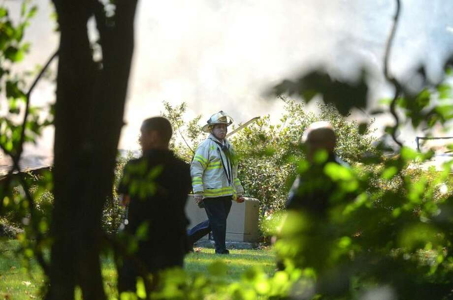 Hour Photo/Alex von Kleydorff Scene of a propane tank explosion as stamford fire personnel knock down a fire that burns after the house was destroyed by the blast on Webbs Hill Rd in Stamford Thuesday afternoon