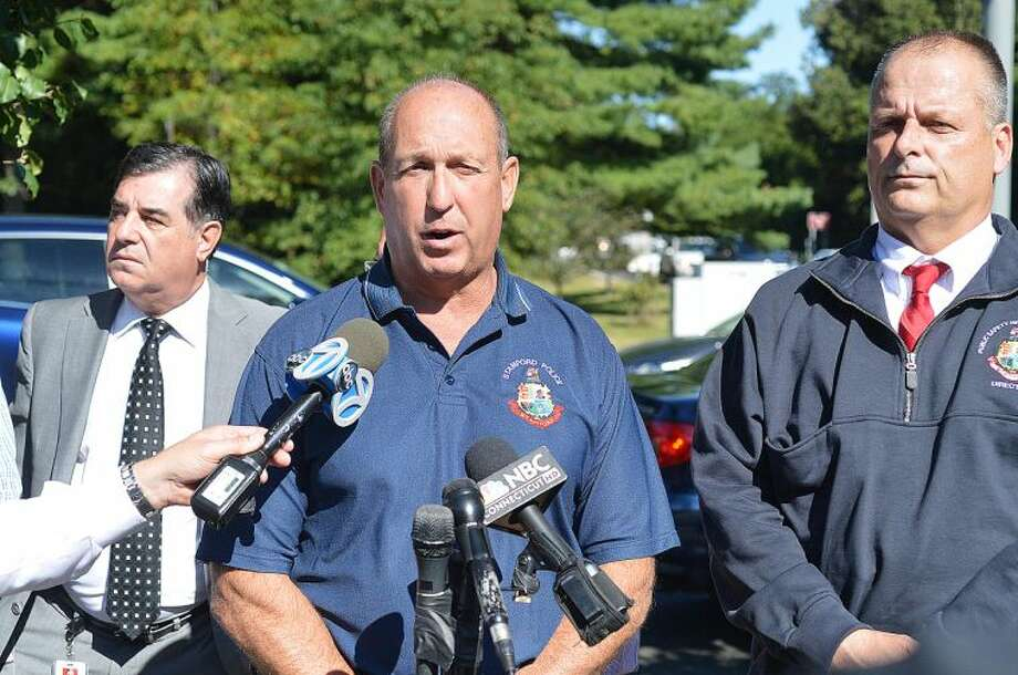 Hour Photo/Alex von Kleydorff Stamford Police Chief Jon Fontneau flanked by Public Safety Director Ted Jankowski and Mayor Michael Pavia talk about the explosion that destroyed a house on Webbs Hill Rd on Tuesday afternoon