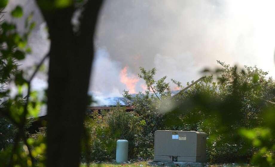 Hour Photo/Alex von Kleydorff. Scene of a propane tank explosion that destroyed a house on Webbs hill Rd in Stamford.