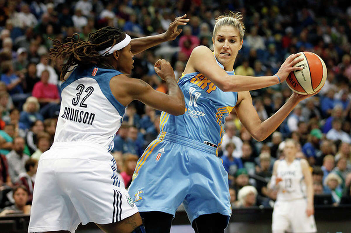 Chicago Sky guard Elena Delle Donne (11) protects the ball against Minnesota Lynx forward Rebekkah Brunson (32) in the first half of a WNBA basketball game, Saturday, Sept. 14, 2013, in Minneapolis. (AP Photo/Stacy Bengs)