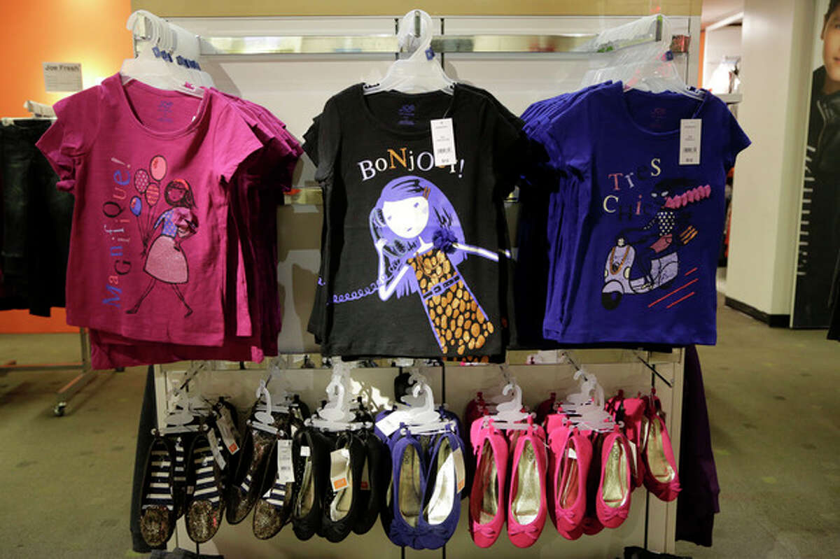 In this July 31, 2013 photo, back-to school fashions are displayed at JC Penney in New York. The government reports on consumer prices for August on Tuesday, Sept 17, 2013. (AP Photo/Mark Lennihan)