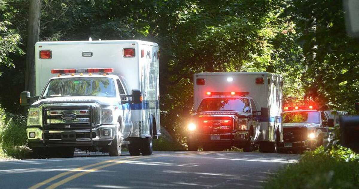 Hour Photo/Alex von Kleydorff Ambulances stage along Webbs Hill rd on Tuesday near the scene of a house explosion