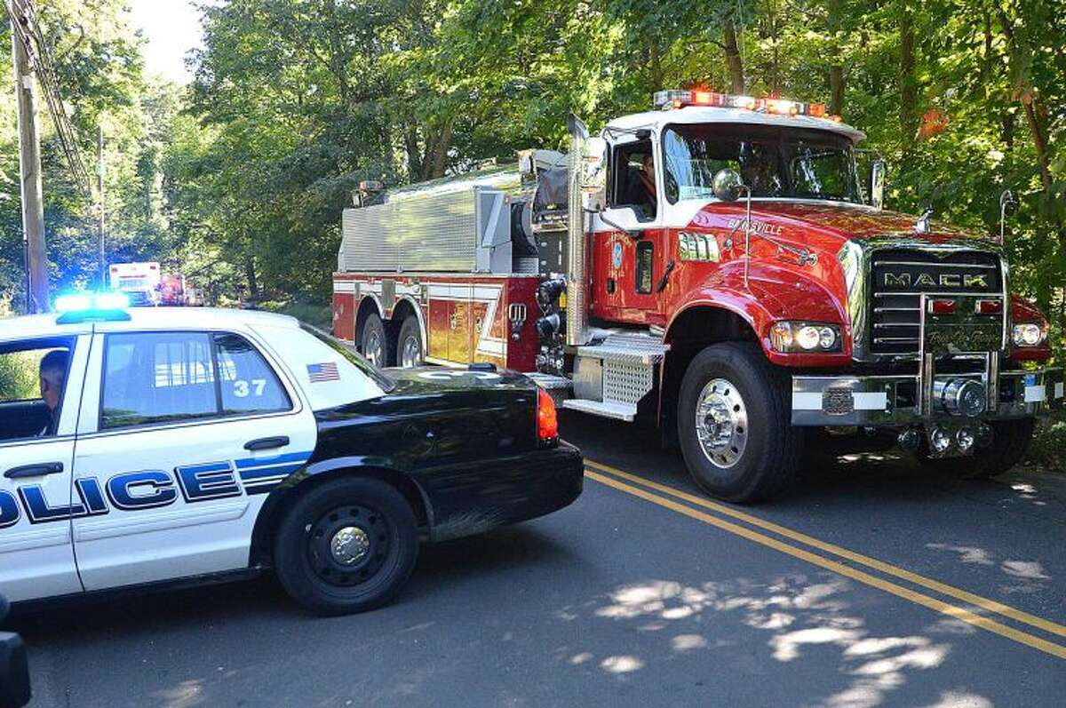 Hour Photo/Alex von Kleydorff Tankers pass around roadblocks on Webbs Hill Rd as they shuttle water from Holts pond off Long Ridge Rd to the scene of a house explosion in Stamford