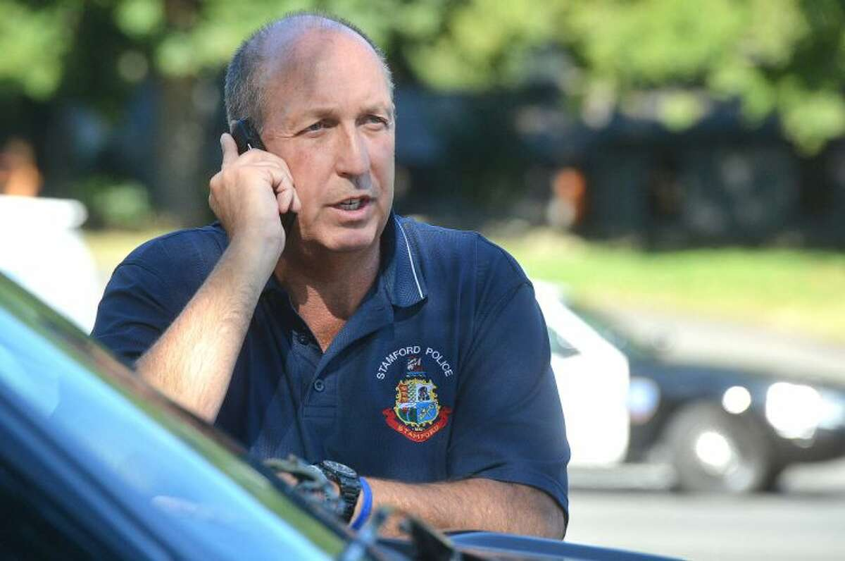 Hour Photo/Alex von Kleydorff Stamford Police Chief Jon Fontneau talks on the phone near where a large propane tank exploded and destroyed a house on Tuesday afternoon