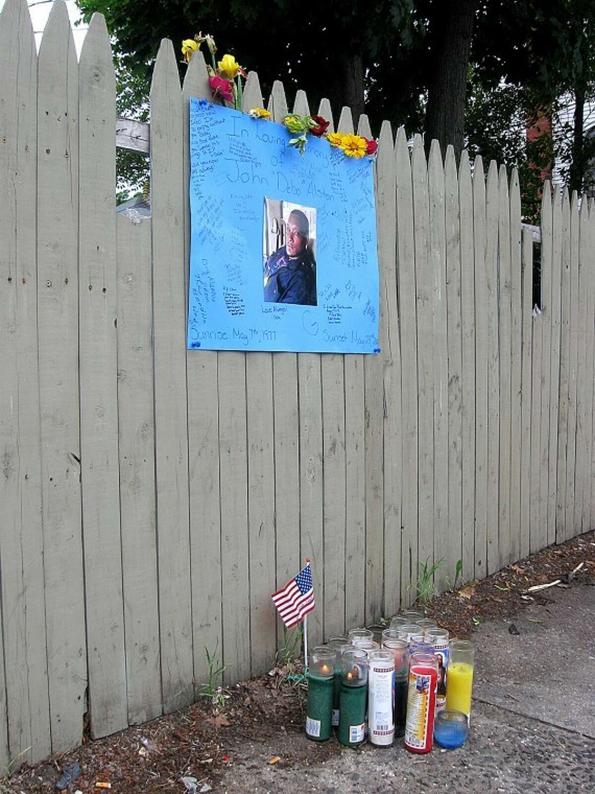 Hour photo/ Chase Wright Shrine in South Norwalk to shooting victim John