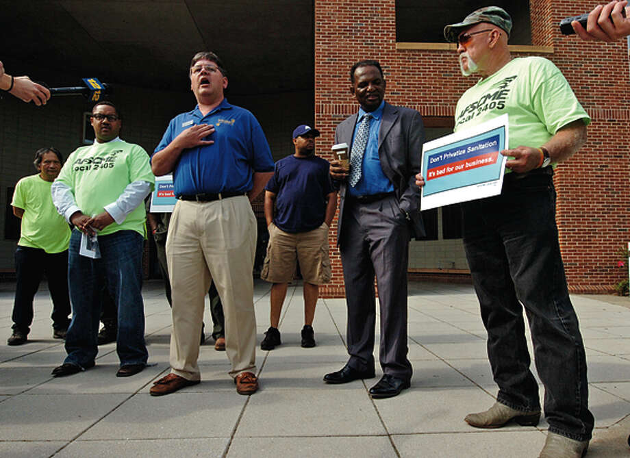 Common Coucilman Matt Miklave and AFSME Local 2405 members who object to garbage privatization speak to the press while protesting outside City Hall. Hour photo / Erik Trautmann / (C)2012, The Hour Newspapers, all rights reserved