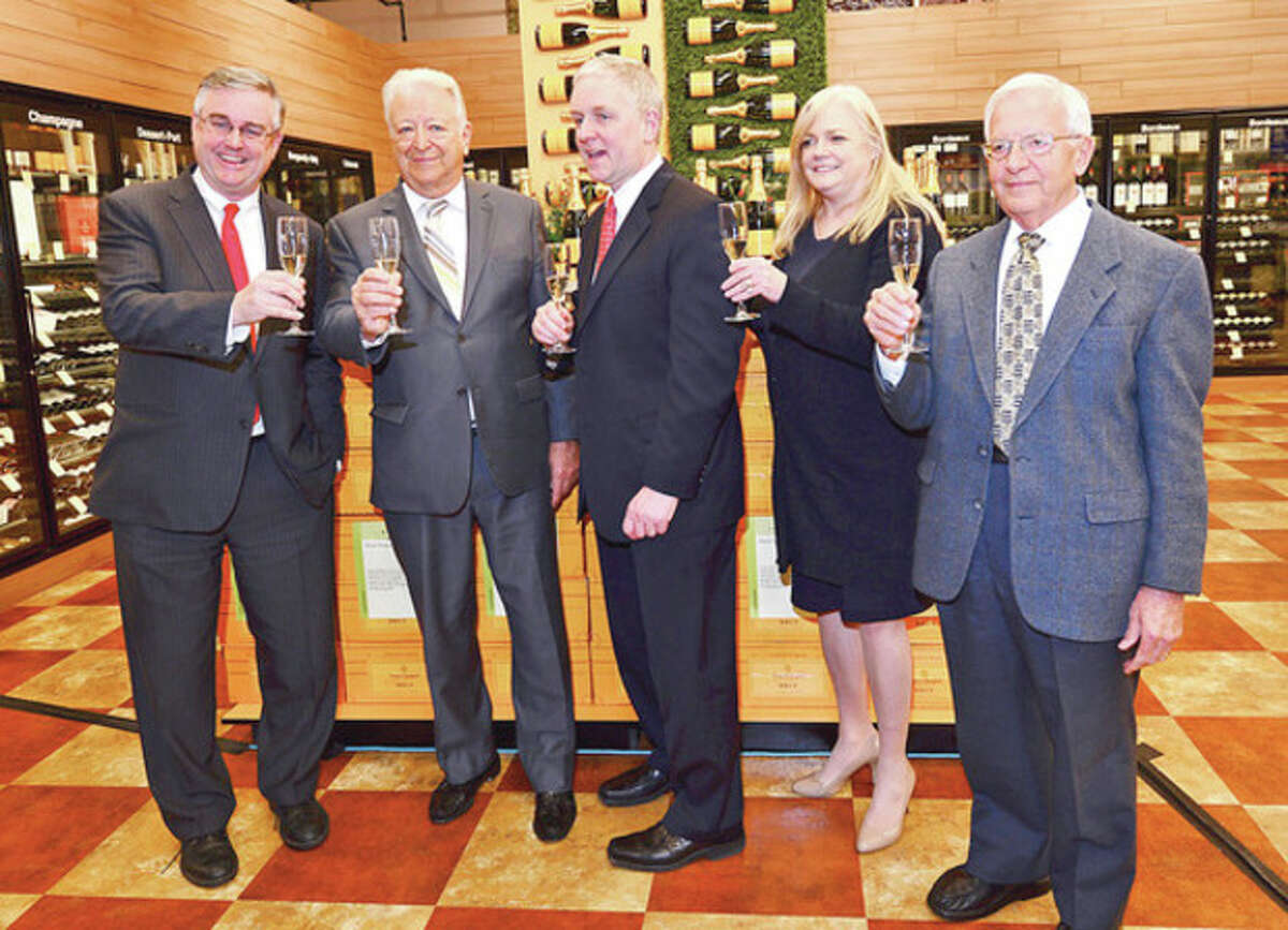 Total Wine co owner David Trone, Norwalk Mayor Richard Moccia, Total Wine co owner Robert Trone, Food Bank Executive Director Kate Lombardo and Food Bank Board Chair Sam Cingari toast the grand opening of Total Wine and More on Main Ave. in Norwalk Thursday afternoon.