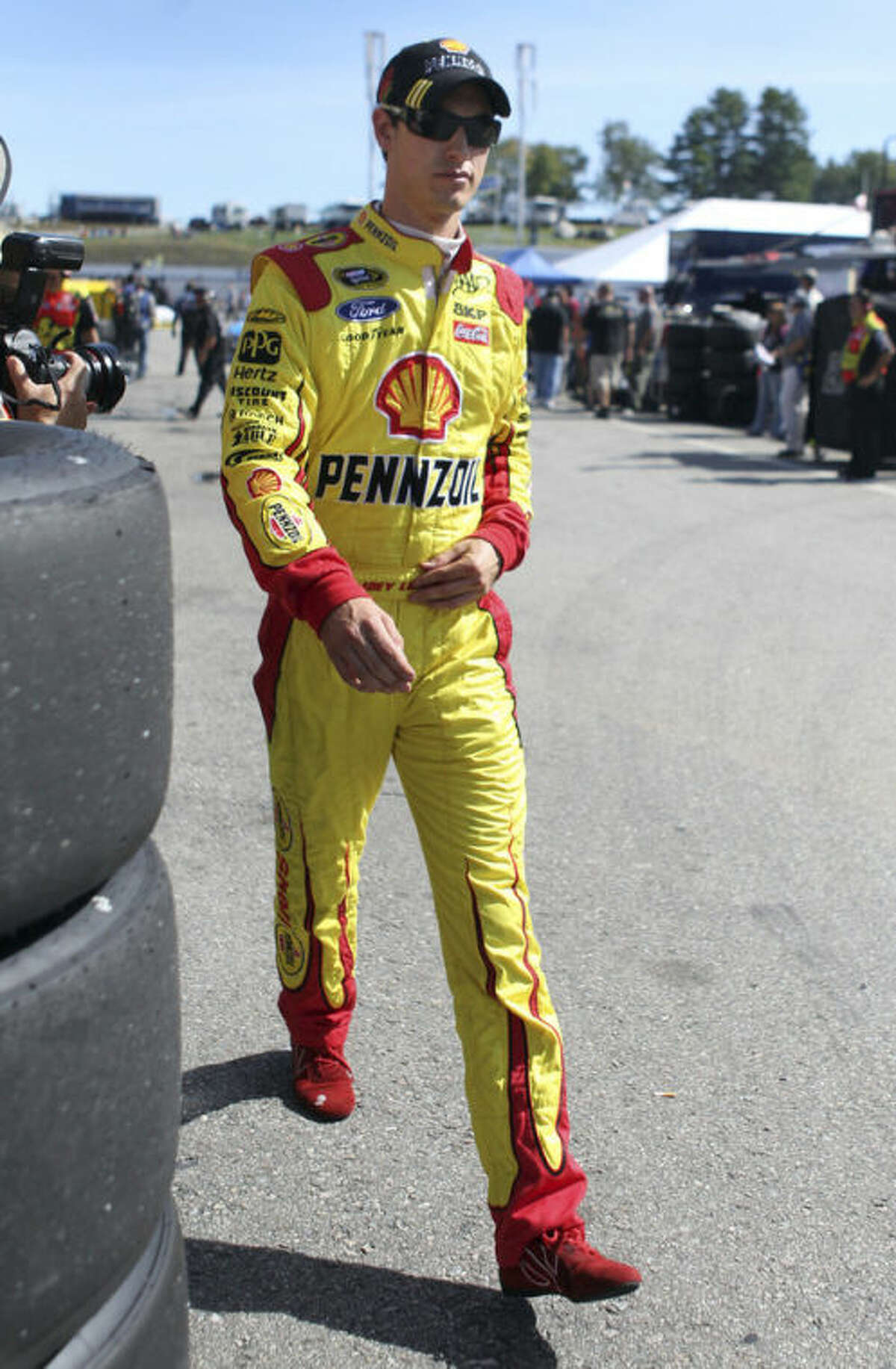 Joey Logano leaves his garage at the conclusion of practice for Sunday's NASCAR Sprint Cup Series auto race at New Hampshire Motor Speedway, Friday, Sept. 20, 2013, in Loudon, N.H. (AP Photo/Mary Schwalm)