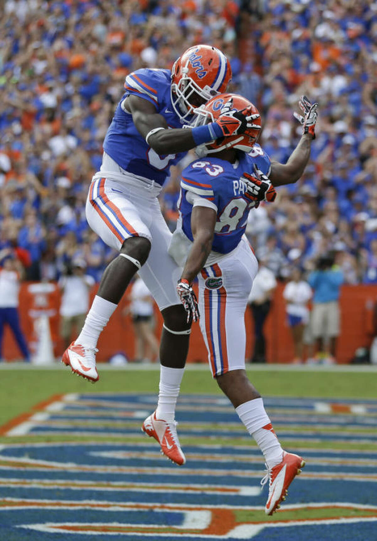 Florida wide receiver Solomon Patton, right, celebrates his 52-yard touchdown pass play against Tennessee with wide receiver Ahmad Fulwood (5) during the first half of an NCAA college football game in Gainesville, Fla., Saturday, Sept. 21, 2013.(AP Photo/John Raoux)