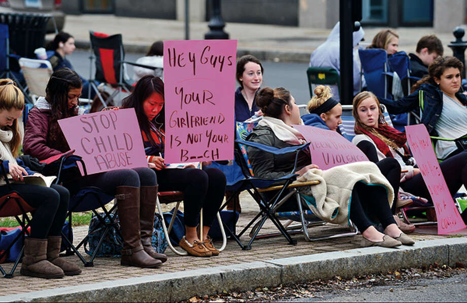 "In this file photo, members of the Center for Youth Leadership participate in ""Occupy Sidewalks"" in front of the Norwalk Museum to raise awareness about child abuse, human trafficking, the rights of immigrants, bullying and dating violence. / (C)2012, The Hour Newspapers, all rights reserved"