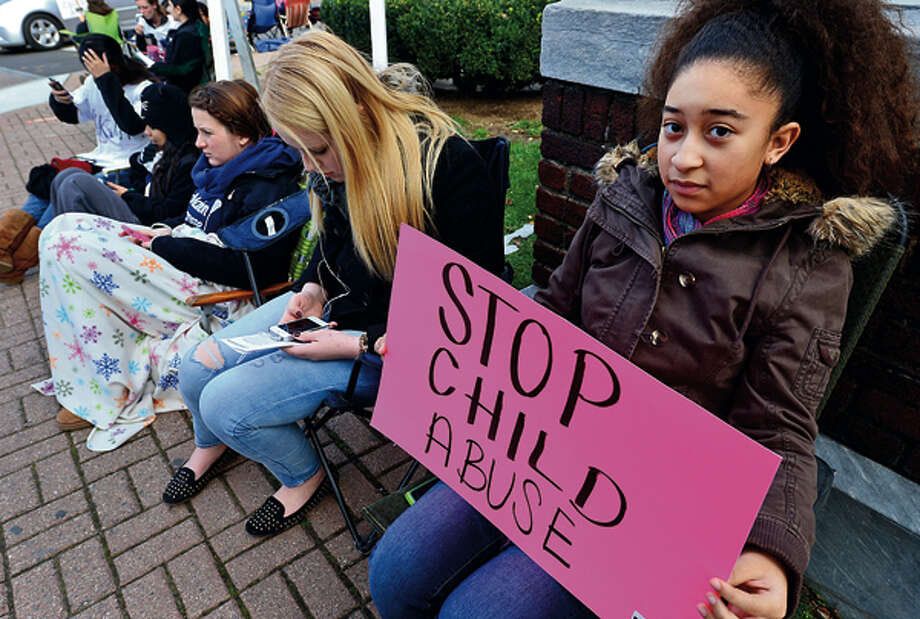 """In this file photo, members of the Center for Youth Leadership, including Ayahna Santaella, participate in """"Occupy Sidewalks"""" in front of the Norwalk Museum to raise awareness about child abuse, human trafficking, the rights of immigrants, bullying and dating violence. / (C)2012, The Hour Newspapers, all rights reserved"""