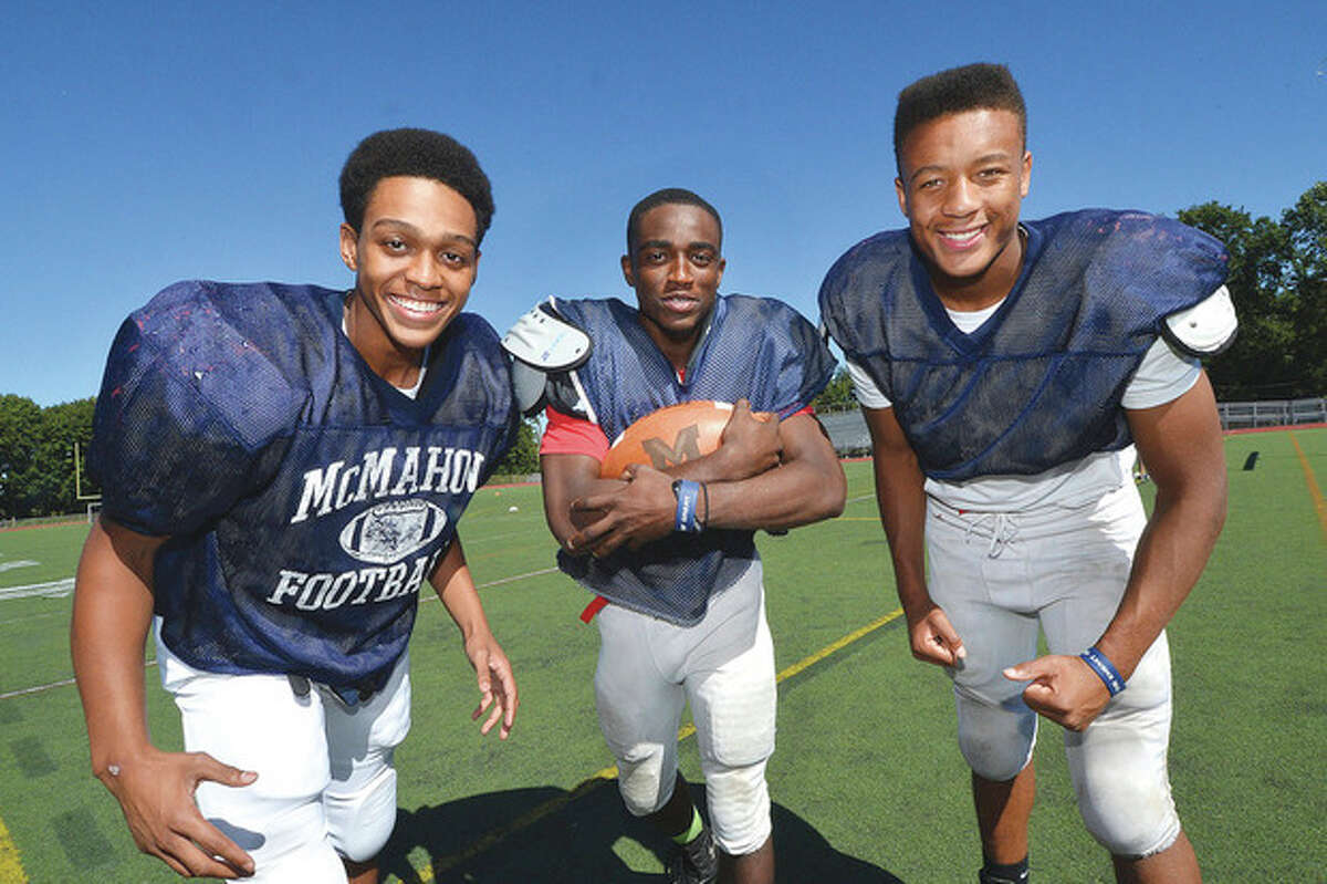 Hour Photo/Alex von Kleydorff Brien McMahon running backs, from left, Timothy Hinton Jr., Tre Forney and Kenneth Keen give the Senators a number of different options and styles in the offensive backfield this season.