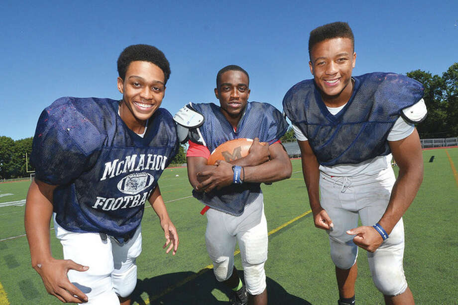 Hour Photo/Alex von KleydorffBrien McMahon running backs, from left, Timothy Hinton Jr., Tre Forney and Kenneth Keen give the Senators a number of different options and styles in the offensive backfield this season.