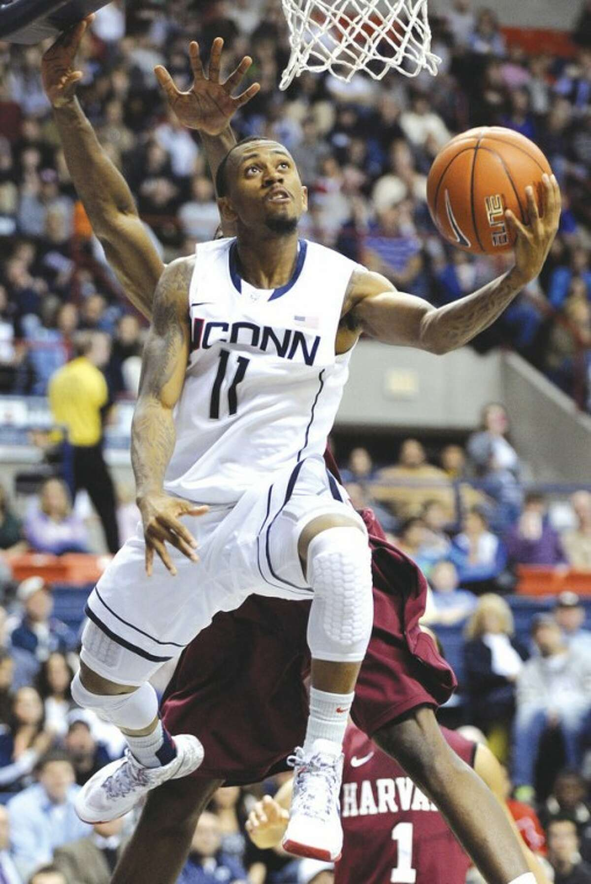 Connecticut's Ryan Boatright drives to the basket during the second half of his team's 57-49 victory over Harvard in an NCAA college basketball game in Storrs, Conn., Friday, Dec. 7, 2012. Boatright scored 16 points in the victory. (AP Photo/Fred Beckham)