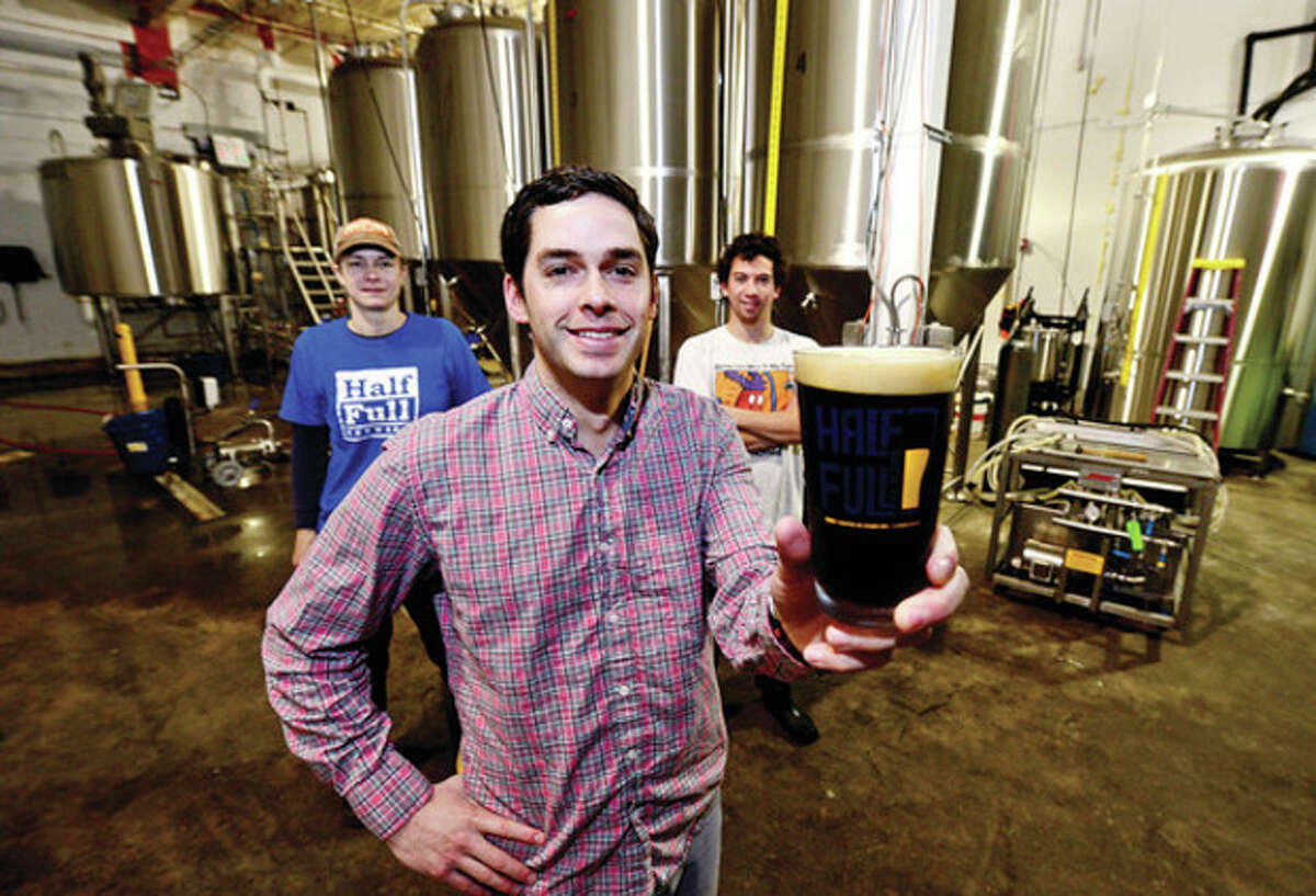 Hour photo / Erik Trautmann Conor Horrigan, owner of Half-Full Brewery, announces his new brew, Half Full Chocolate Coffee Brown Ale, a collaboration with Darien coffee shop.