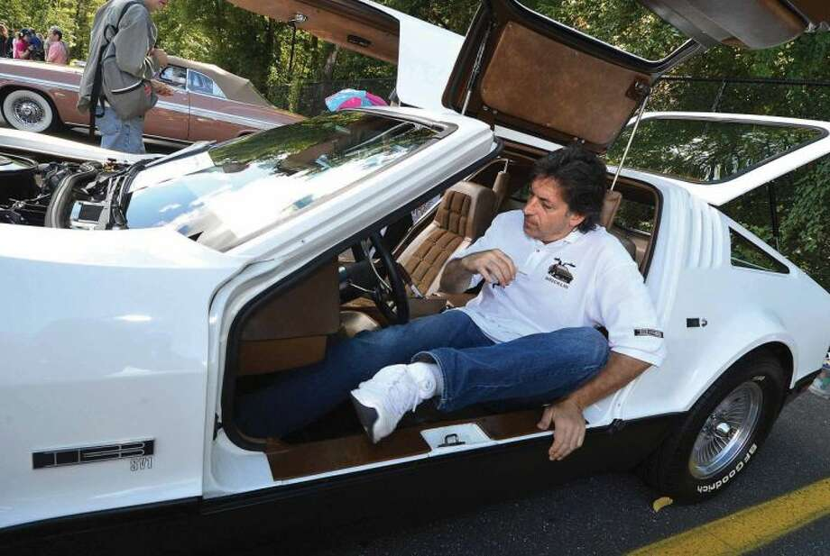 Hour Photo/Alex von Kleydorff. Wilton's Rick Barone gets in his 1974 Bricklin SV1 while showing at Westons Alden Sherman Classic Car Show on Sunday