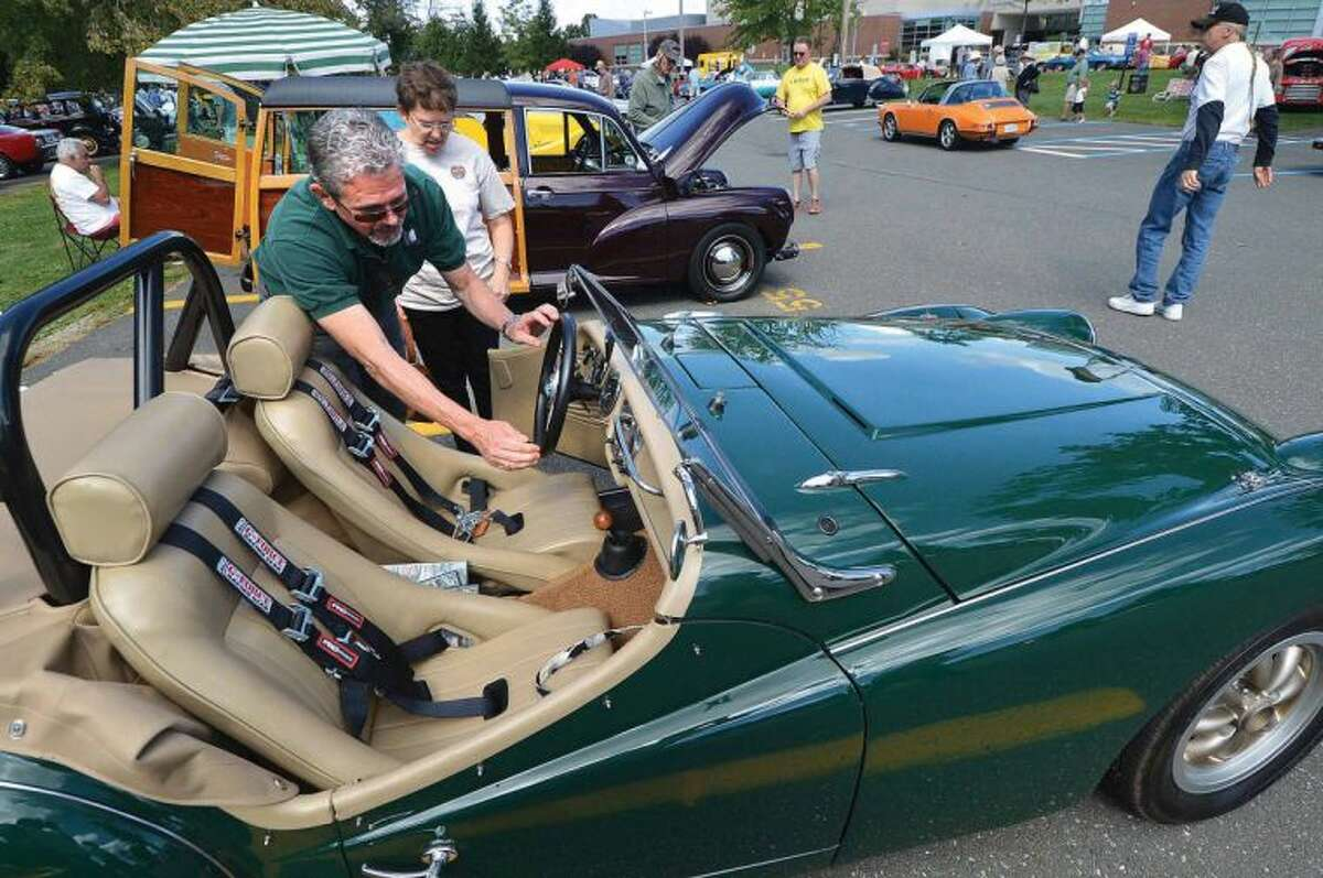 Hour Photo/Alex von Kleydorff. Wilton's Kevin and Moira Craw get ready to start up their 1963 Triumph TR3 at The Alden Sherman Classic Car show in eston. A 5 plus year project for him to re build and customize the car so it is car show caliber.