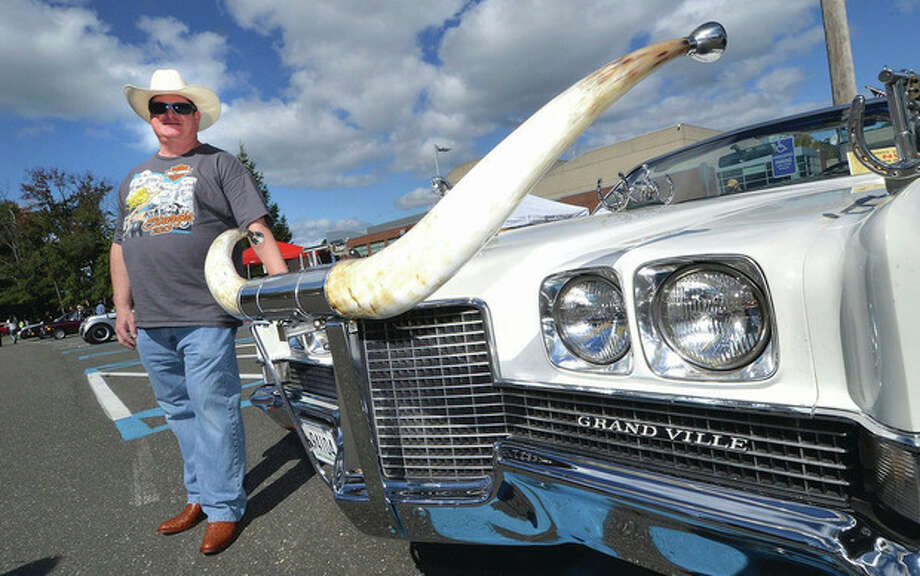 "Hour photos / Alex von KleydorffWeston's Bob Ferguson at the front of his heavily customized 1971 Pontiac Grand Ville ""Westerner."" The horns are just part of the western theme of the car that has 150 silver dollars attached to the interior and some two dozen six shooters attached throughout. Famed Western clothes designer Nudie Cohen made one a year and this one belonged to Buck Owen."