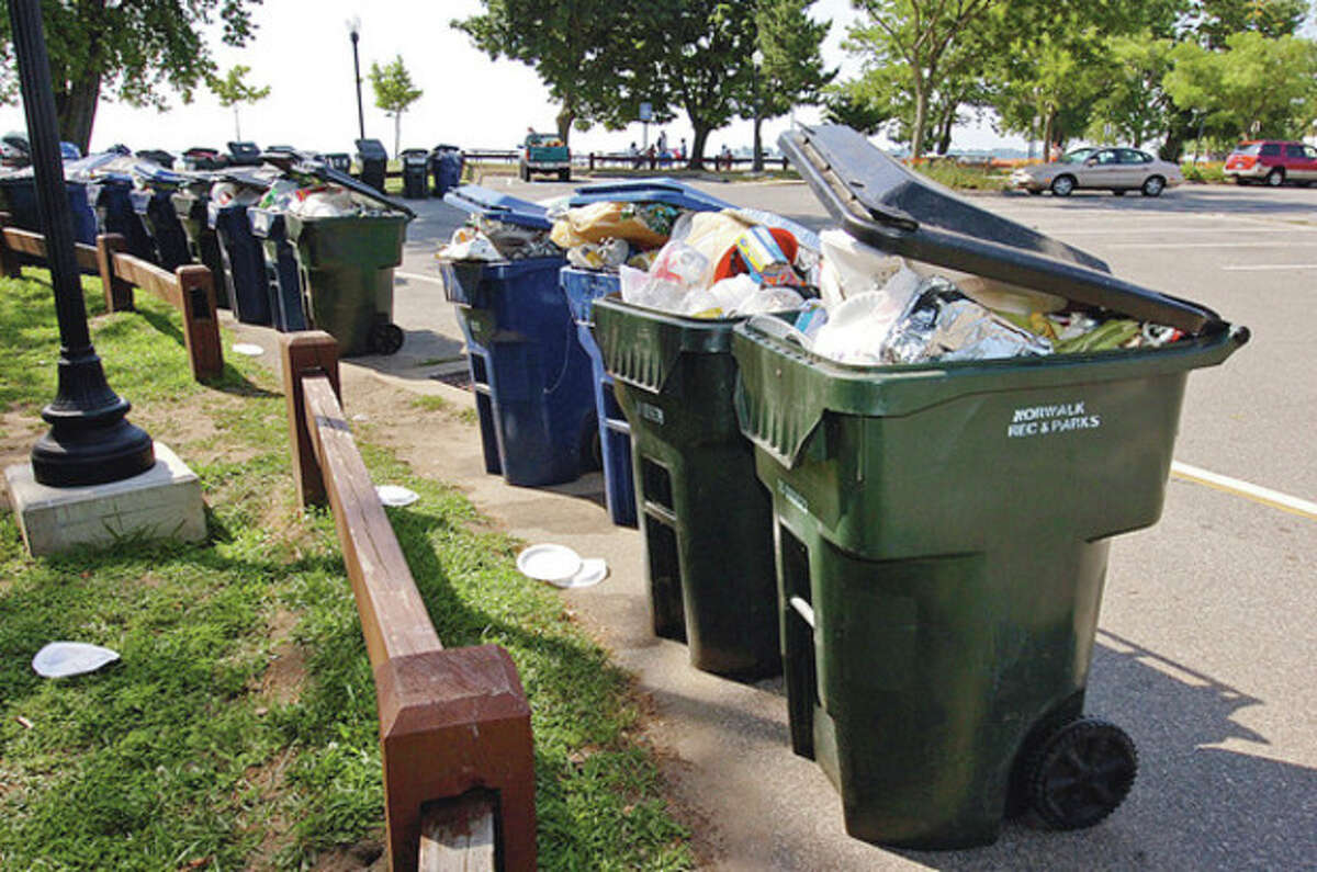 Hour photo / Erik Trautmann Above and below, garbage piled up Thursday morning at Shady Beach following the Independence Day holiday Wednesday when beachgoers jammed the park.