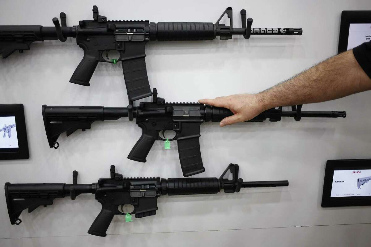 AR-15 rifles are displayed at the NRA's annual meeting last month in Louisville, Ky. NRA officials have agreed to discuss a proposal to ban some people on certain watch lists from buying weapons.