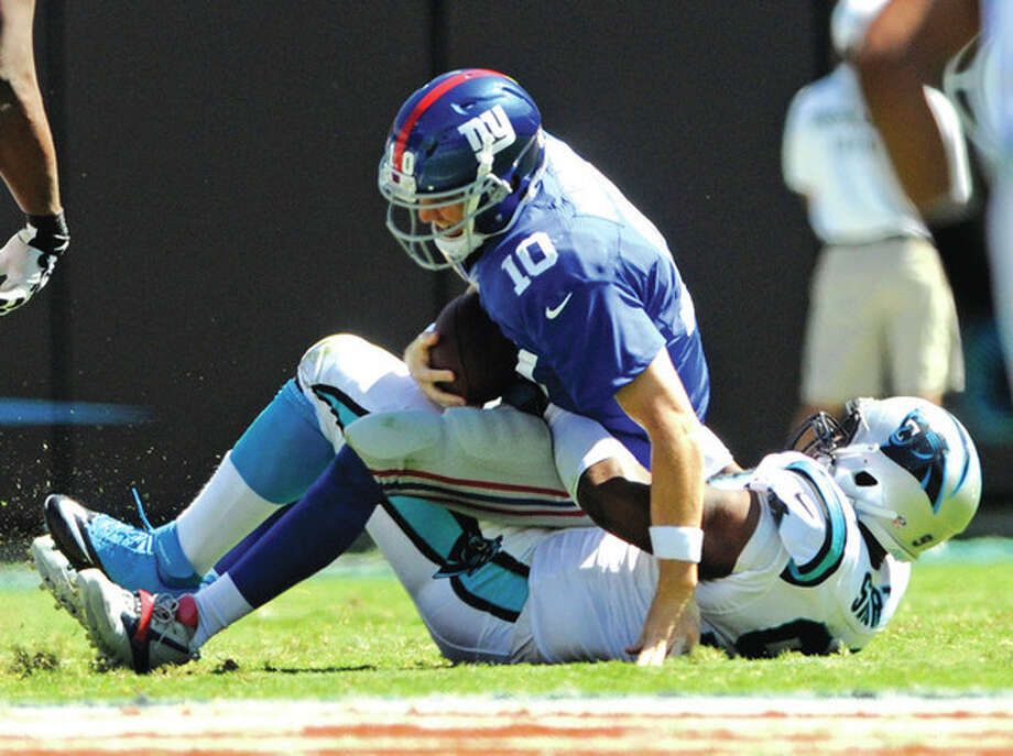 AP photoNew York Giants quarterback Eli Manning (10) is sacked by Kawann Short of the Carolina Panthers during Sunday's game. The Panthers breezed to a 38-0 victory, dropping the Giants to 0-3 on the season. The only thing that cushioned the fall for Manning was Short. / FR34342 AP